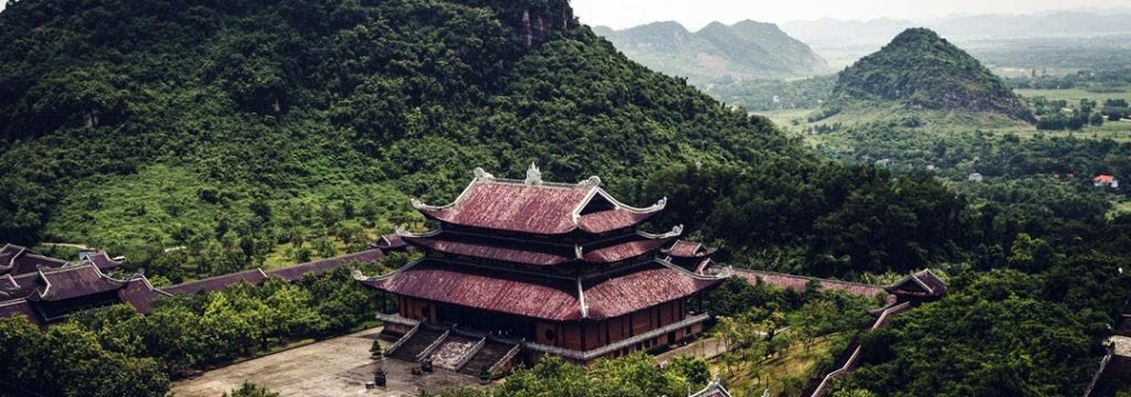 Temple surrounded by mountains inTam Coc, Vietnam