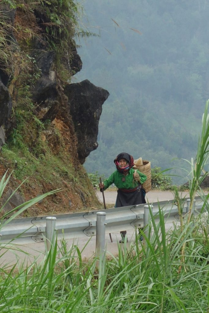 Ha Giang, Woman walking along the road