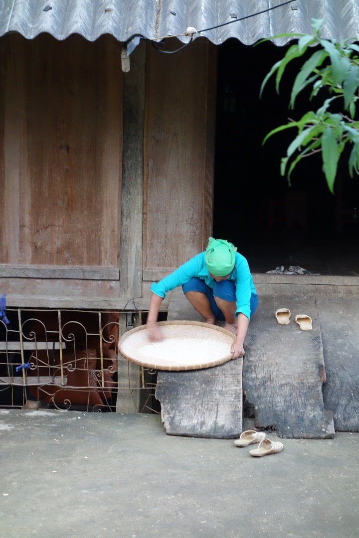 Local woman cleaning the rice - Du Gia - Vietnam