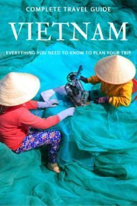 Two women making a blue fishing net in Vietnam