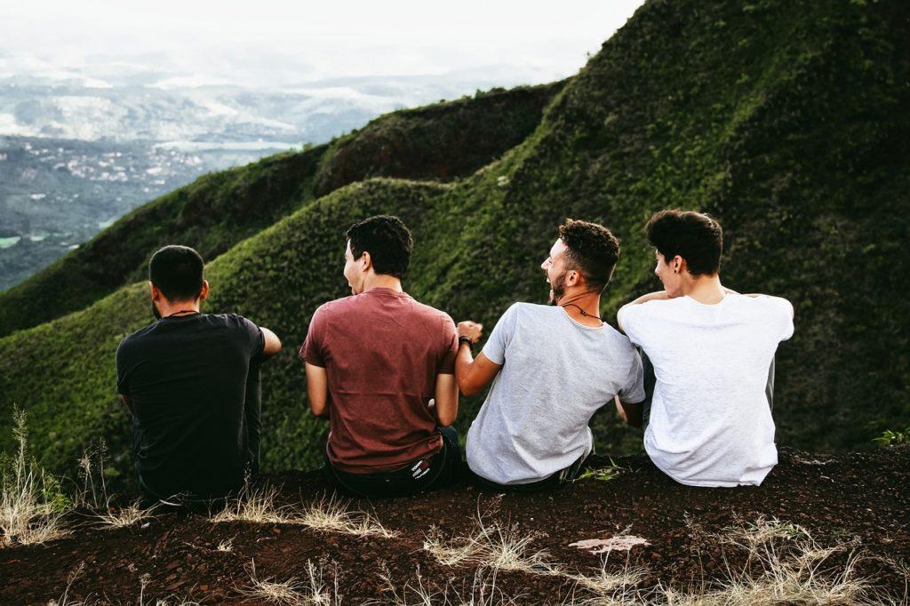 Friends sitting near a cliff
