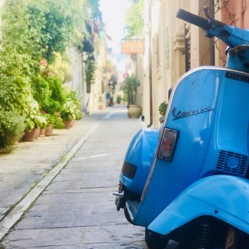 Scooter in a small paved street in Crete, Greece